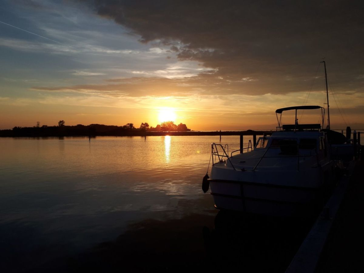 Boat Holidays sunset in houseboat Venetian lagoon